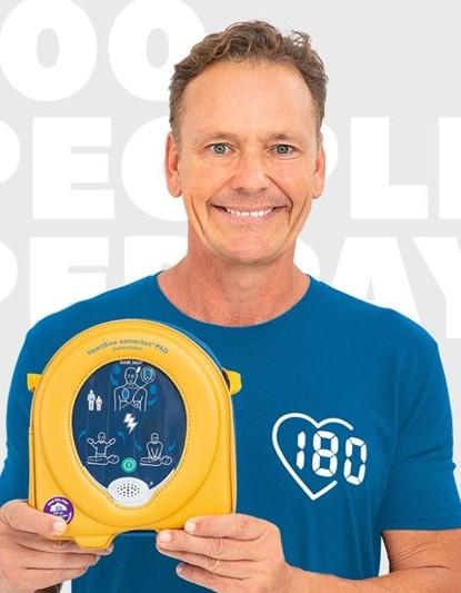 Guy Leech holding a defibrilator
