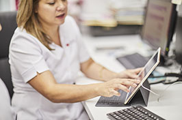 pharmacy assistant operating a tablet device